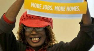 Jazzie Collins demonstrating for more jobs and more housing