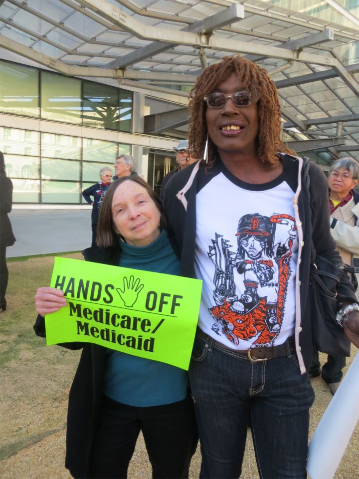 Jazzie Collins with colleague Donna Willmott calling for Hands Off Medicare / Medicaid